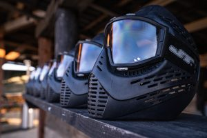 Paintball masks lined in a row